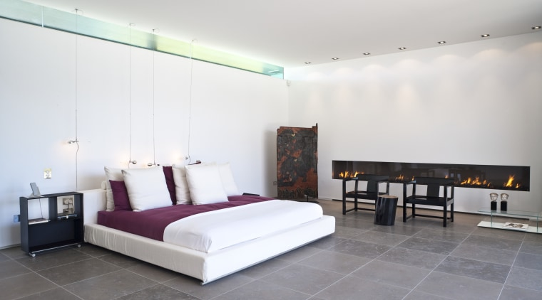 Contemporary bedroom with floor tiles and fireplace architecture, bed frame, bedroom, ceiling, floor, furniture, interior design, real estate, room, suite, wall, white, gray