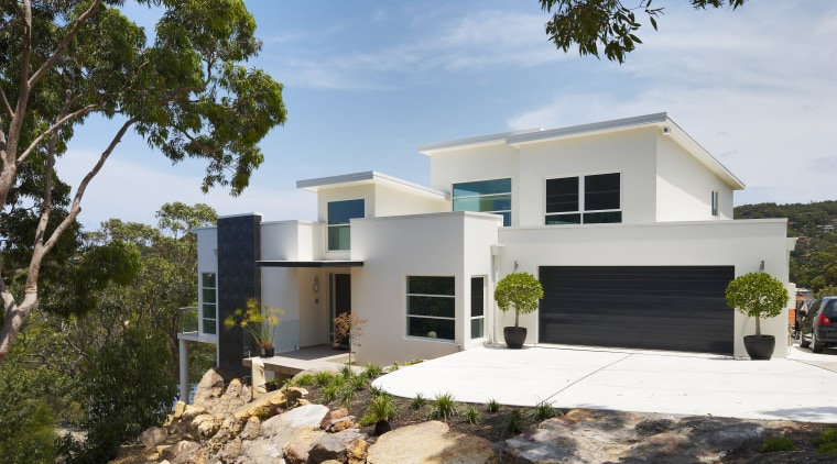 Exterior view of contemporary home designed and built architecture, elevation, facade, home, house, property, real estate, white