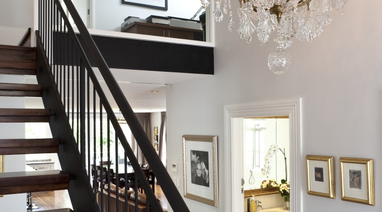 Close up view of the stairway and chandelier baluster, ceiling, dining room, estate, floor, flooring, handrail, hardwood, home, house, interior design, light fixture, lighting, molding, room, stairs, wall, wood, wood flooring, gray