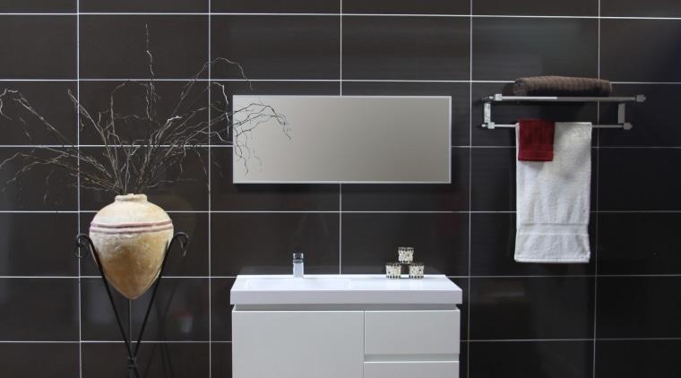 Bathroom showing accessories & basin sink bathroom, bathroom accessory, cabinetry, floor, flooring, furniture, hardwood, interior design, product design, sink, tap, tile, wall, wood, wood flooring, black
