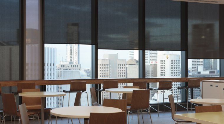 Interior view of 34-Story building with blinds from architecture, classroom, daylighting, furniture, institution, interior design, office, table, window, black, brown