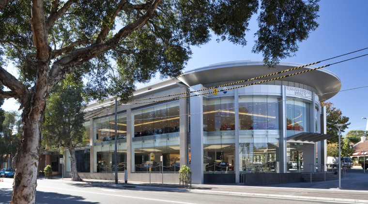 Ferrari showroom architecture, building, commercial building, corporate headquarters, facade, mixed use, real estate, tree, black, gray