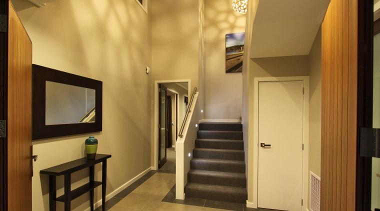 View of entranceway featuring tiled floors, stairway, doors, ceiling, interior design, brown, orange