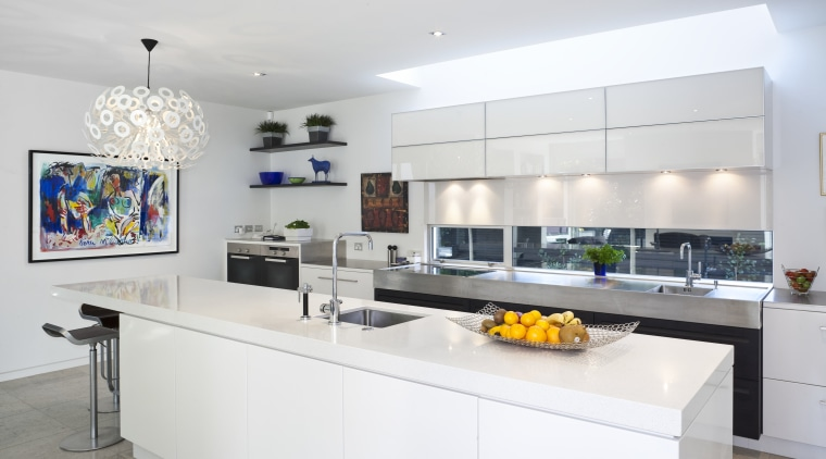 Modern kitchen features brilliant white panelling countertop, interior design, kitchen, real estate, white