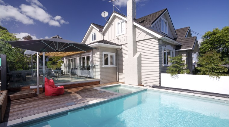 View of an outdoor area which features a cottage, estate, facade, home, house, property, real estate, residential area, swimming pool, villa