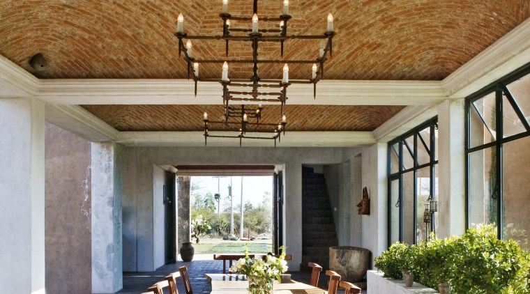 View of dining area. beam, ceiling, dining room, estate, home, interior design, living room, real estate, table, brown, gray