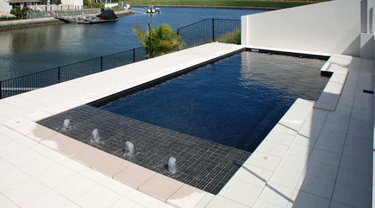 View of the pool & water features composite material, condominium, daylighting, floor, flooring, leisure, property, real estate, swimming pool, water, white