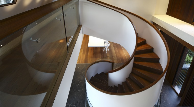 View of the spiral stairway in this contemporary architecture, furniture, handrail, interior design, product design, stairs, table, wood, black, brown