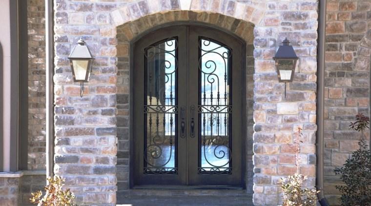 Grand entrance with brick wall & iron door arch, brick, brickwork, door, facade, gate, iron, window, gray