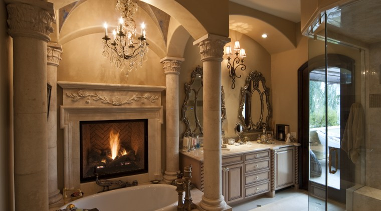 Bathroom with pillars and arches over bath. Vanity ceiling, estate, fireplace, hearth, home, interior design, living room, room, wood burning stove, brown