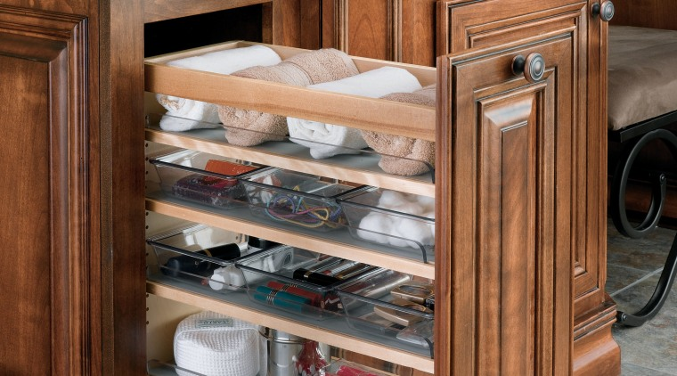 View of cabinetry which features storage systems from cabinetry, chest of drawers, drawer, furniture, hardwood, wood stain, brown, gray