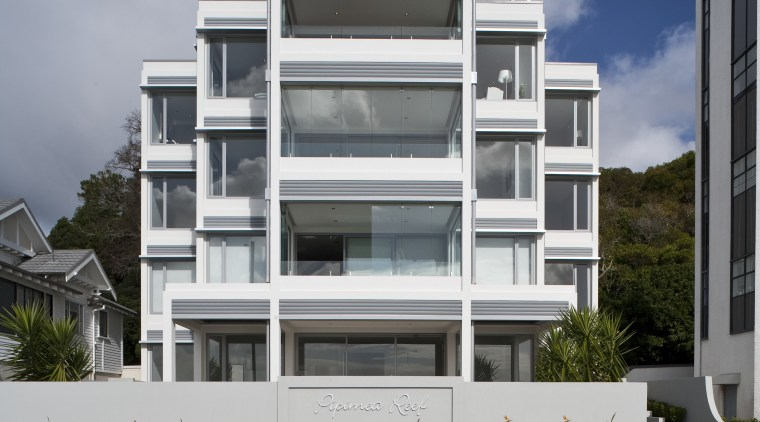 Exterior view of apartment building which features balconies apartment, architecture, building, commercial building, condominium, corporate headquarters, elevation, facade, home, house, mixed use, neighbourhood, property, real estate, residential area, sky, window, gray, black