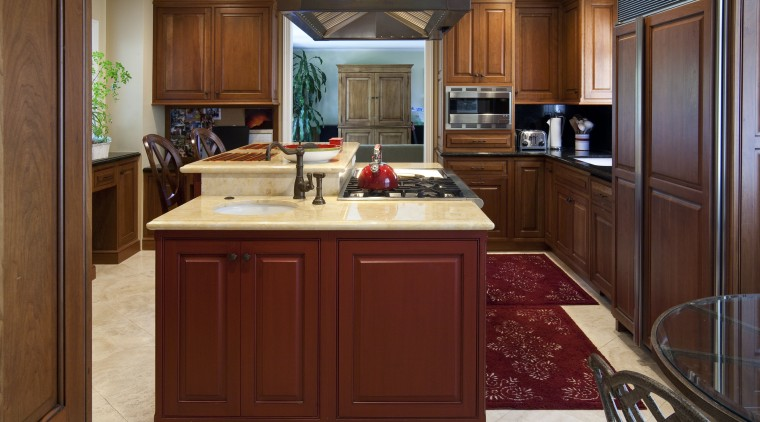 View of a traditional-styled kitchen designed by Pacific cabinetry, countertop, cuisine classique, hardwood, interior design, kitchen, room, red, brown