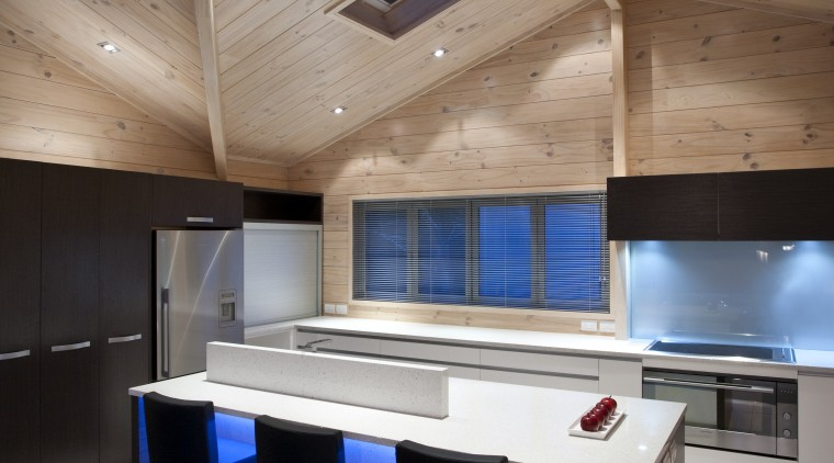 View of the contemporary kitchen area which features architecture, ceiling, daylighting, floor, furniture, house, interior design, table, gray