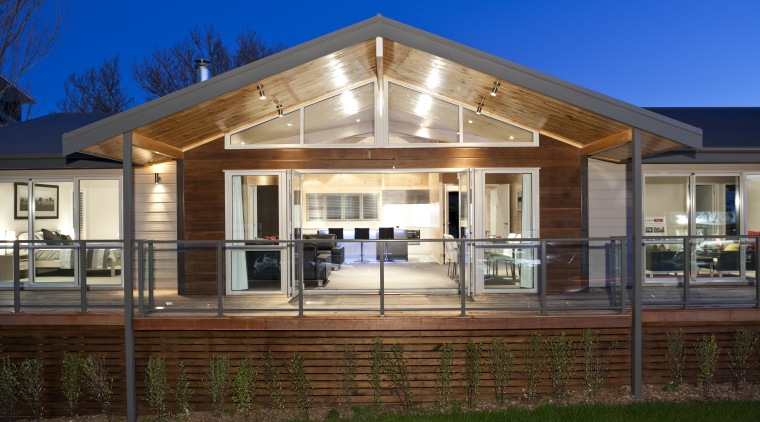 Exterior view of this contemporary home architecture, cottage, elevation, estate, facade, farmhouse, home, house, lighting, porch, property, real estate, residential area, roof, siding, window, brown, blue