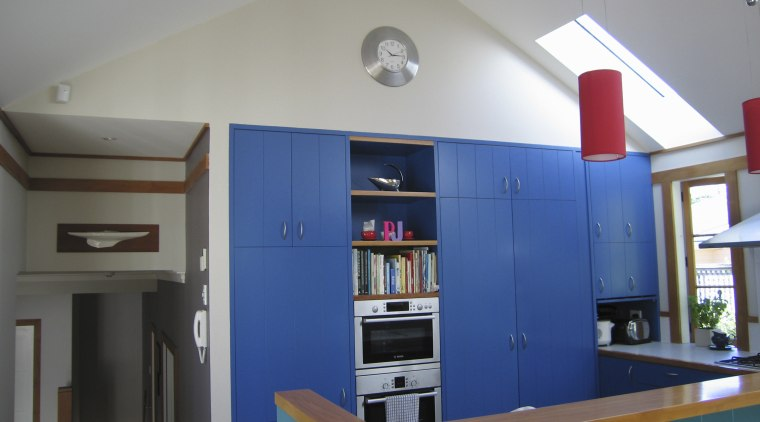 View of kitchen prior to renovations. furniture, house, interior design, room, shelving, gray