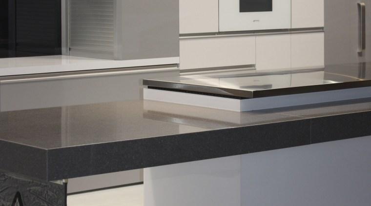 View of a contemporary kitchen area countertop, furniture, interior design, kitchen, product design, gray