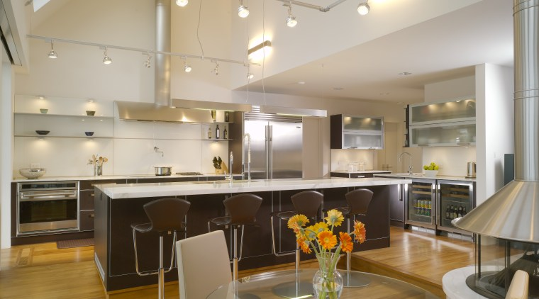 View of contemporary kitchen which features island, stainless apartment, architecture, ceiling, countertop, interior design, kitchen, loft, real estate, gray, brown