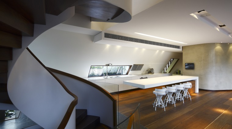 View of spiral staircase and kitchen area featuring architecture, ceiling, daylighting, house, interior design, product design, table, gray, black