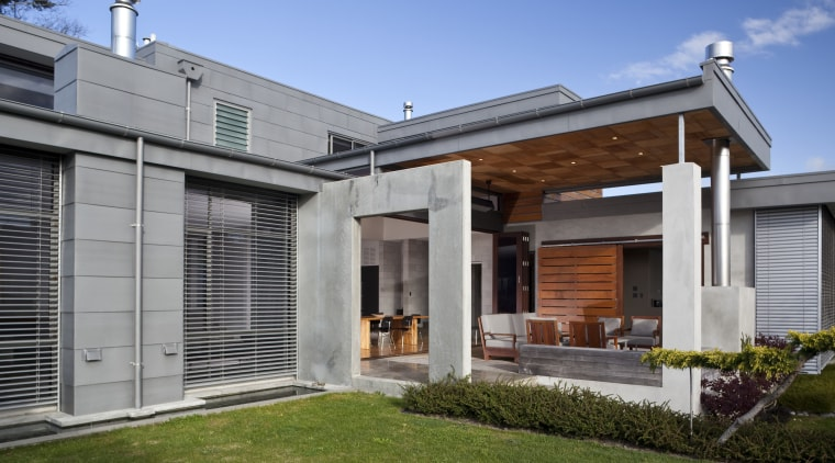Exterior view of flat roof house which is backyard, elevation, estate, facade, home, house, orangery, property, real estate, residential area, roof, siding, window, yard, gray