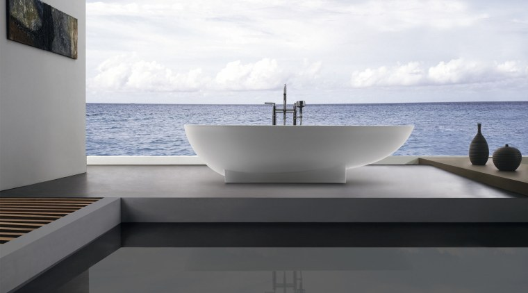 View of this contemporary bathroom architecture, bathtub, plumbing fixture, product design, sea, sky, water, white, gray