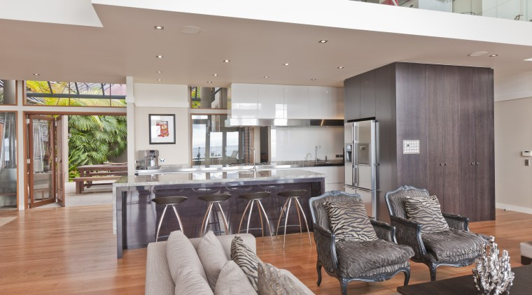 View of open-plan kitchen featuring an island with house, interior design, living room, real estate, table, gray