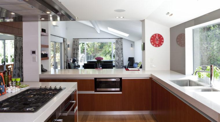 View of kitchen which features oak floors, kitchen countertop, interior design, kitchen, real estate, white