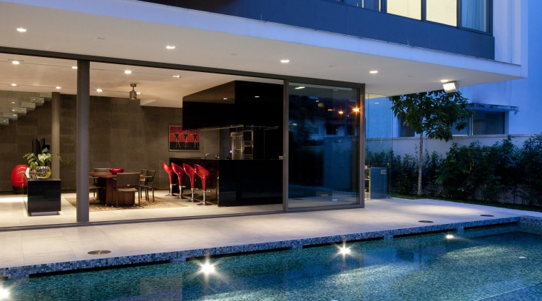 Exterior view of the poolside terrace at the architecture, condominium, estate, home, house, leisure, lighting, property, real estate, reflection, swimming pool, water, blue