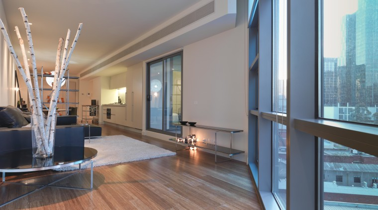 View the lounge area of an apartment at apartment, architecture, ceiling, condominium, daylighting, estate, floor, flooring, hardwood, interior design, living room, loft, penthouse apartment, property, real estate, window, wood, wood flooring, gray