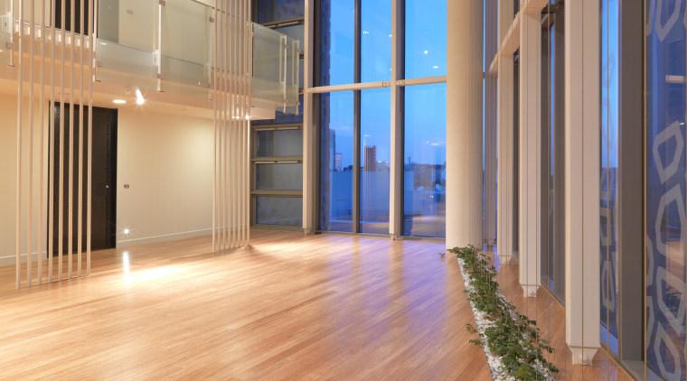 Interior view of the atrium of the Triptych apartment, architecture, estate, floor, flooring, hardwood, interior design, laminate flooring, lobby, real estate, wood, wood flooring, orange