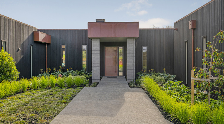 A strong entrance form with copper clad door