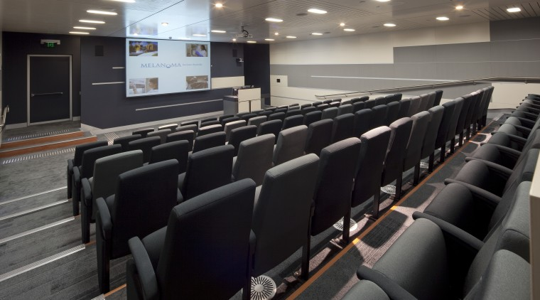 Interior view of the Poche Centre which features auditorium, conference hall, black, gray
