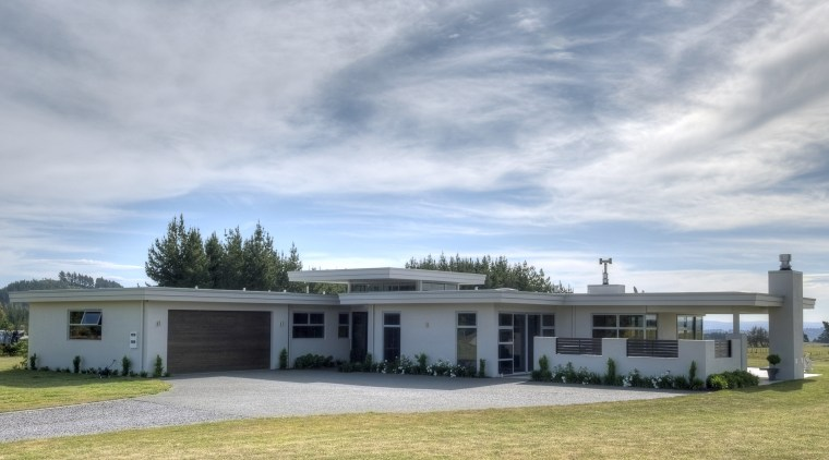 View of a house clad in Rockcote plaster. cloud, cottage, elevation, estate, farmhouse, home, house, landscape, property, real estate, roof, sky, gray