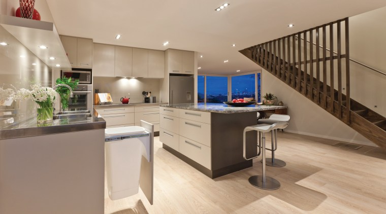 View of a large open-plan kitchen which features countertop, floor, interior design, kitchen, real estate, orange, brown
