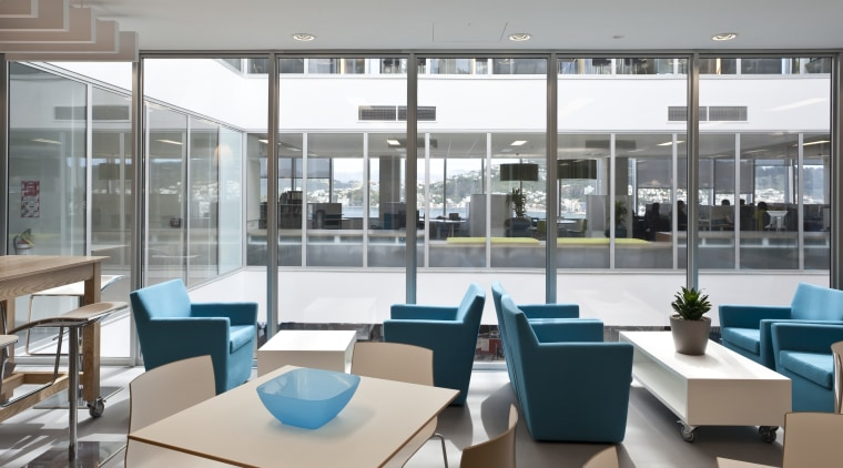 View of the Aserton Centre with glass roofed daylighting, furniture, interior design, office, table, gray