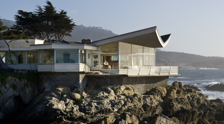 View of the oceanfront Butterfly House in Carmel architecture, building, cottage, home, house, property, real estate, reflection, sky, water, black, gray