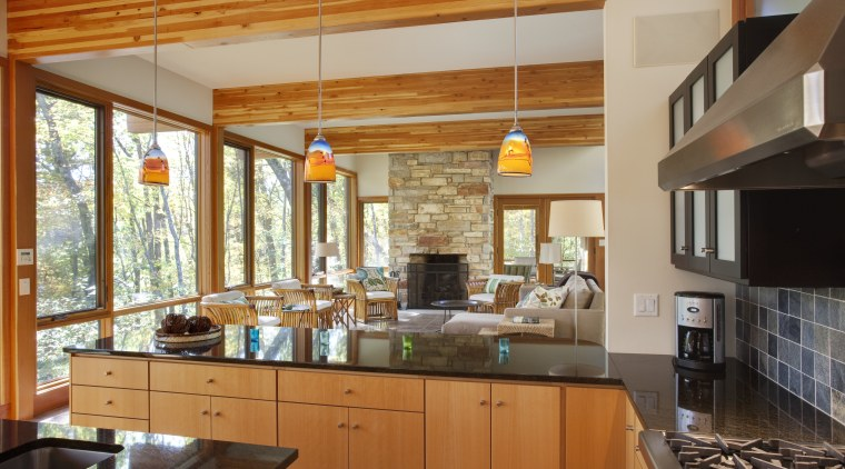 View of sunken open-plan kitchen with wooden cabinetry, cabinetry, ceiling, countertop, cuisine classique, interior design, kitchen, real estate, brown