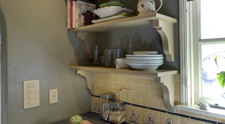 View of Spanish-style home with open shelving and cabinetry, countertop, furniture, home, house, interior design, kitchen, room, shelf, wall, brown, gray