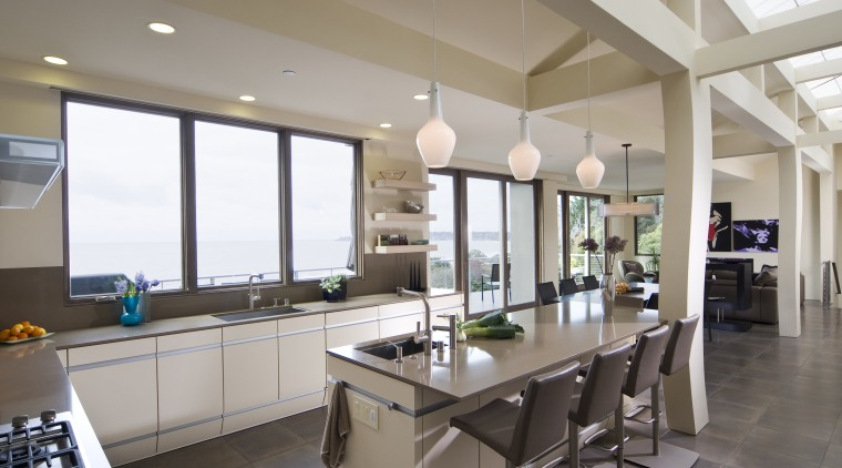 View of neutral-toned kitchen and dining space, featuring countertop, interior design, kitchen, property, real estate, window, gray