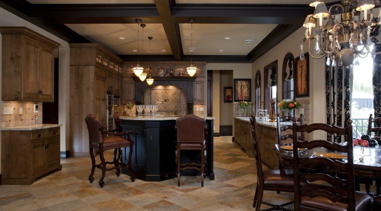 View of kitchen with aged look, featuring internally ceiling, dining room, flooring, interior design, restaurant, brown