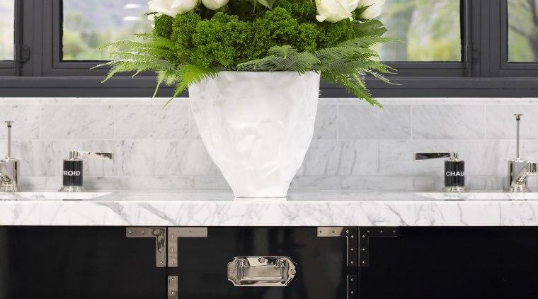 Jamie Herzlinger has designed this master suite to flower, furniture, home, interior design, table, white, white, black
