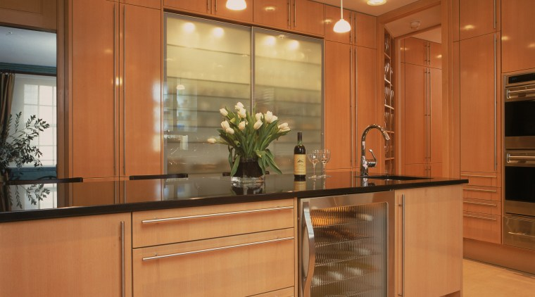 View of remodeled kitchen in a Park Avenue cabinetry, countertop, cuisine classique, hardwood, interior design, kitchen, room, under cabinet lighting, orange, brown
