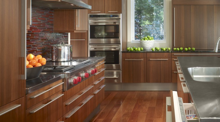 View of a kitchen which combines commerical touches cabinetry, countertop, cuisine classique, floor, flooring, hardwood, interior design, kitchen, laminate flooring, real estate, room, wood, wood flooring, brown, gray