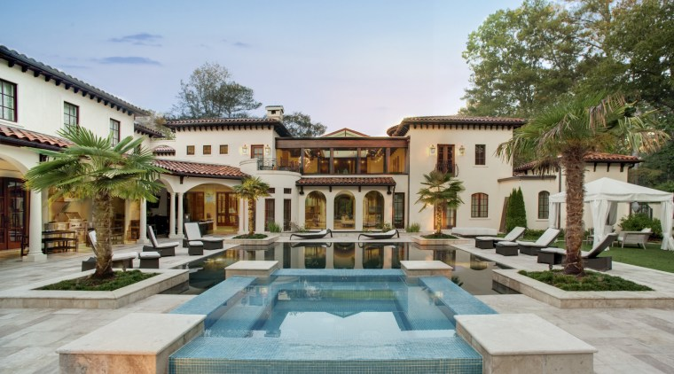 View of traditional home and pool area. courtyard, estate, hacienda, home, hotel, mansion, property, real estate, resort, swimming pool, villa, gray