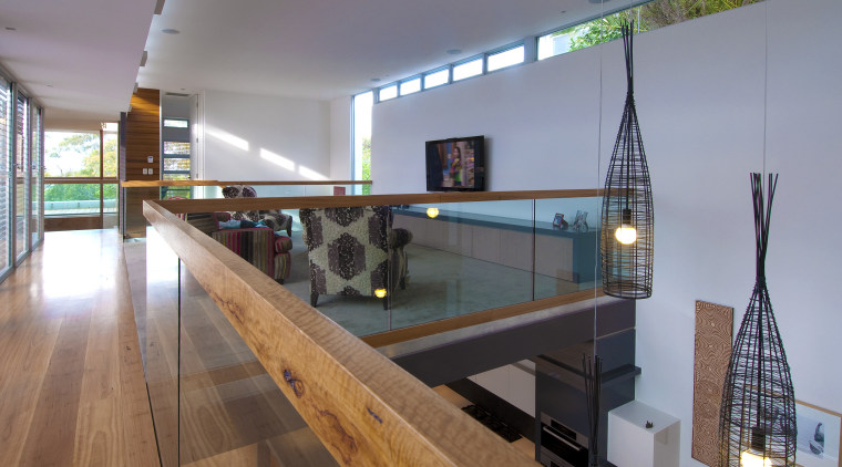View of mezzanine area with wooden floor and glass, handrail, interior design, gray