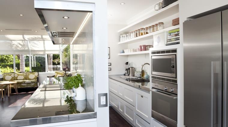 The kitchen is designed by Robyn Labb Kitchens. countertop, home appliance, interior design, kitchen, refrigerator, gray