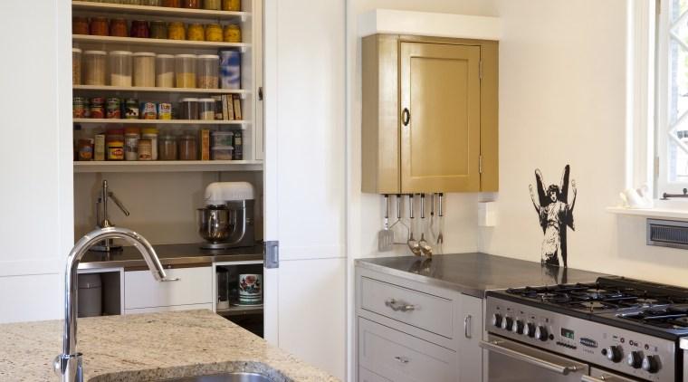 Interior Designer and Kitchen Designer Celia Visser. Modern countertop, home, interior design, kitchen, living room, room, gray, brown