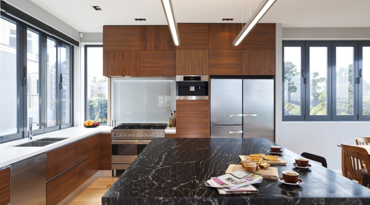 Designer Shane George. Open-plan space. Small amount of cabinetry, countertop, cuisine classique, interior design, kitchen, living room, window, white