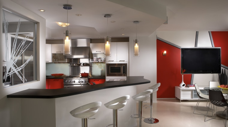 Interior view of contemporary apartment with red feature countertop, interior design, kitchen, real estate, gray