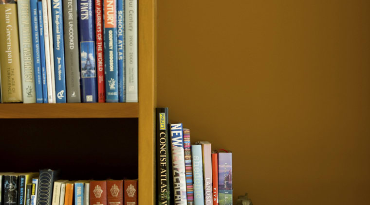 View of yellow wall, painted using Resene paints. book, bookcase, bookselling, furniture, library, public library, shelf, shelving, brown
